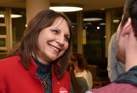 Bernadette Mazuerk Melnyk talks to a student