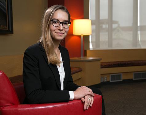 Alina Sharafutdinova sitting in a red chair