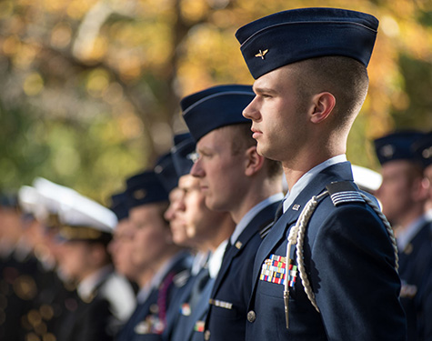 young men and women standing in uniform
